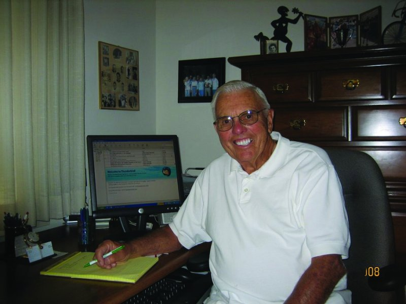 Verne Scott at his desk