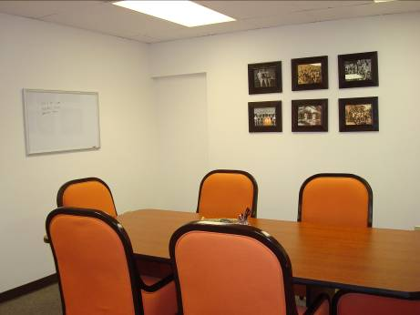 The conference table and white board provide space for meeting and brainstorming