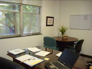 Rob's office includes additional space for a small conference table and chairs