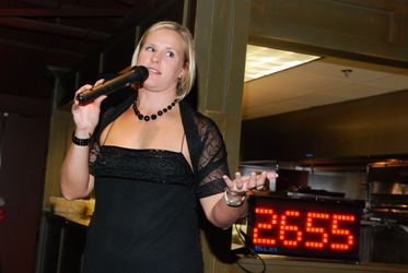 Auctioneer Terese Schurger at the Indy SwimFit auction